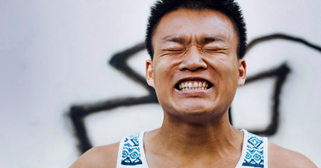 Man Clenching his teeth